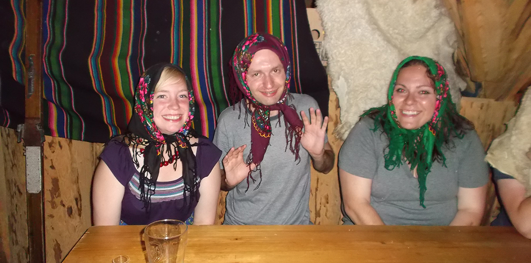 3 UIC students in traditional Polish headwear